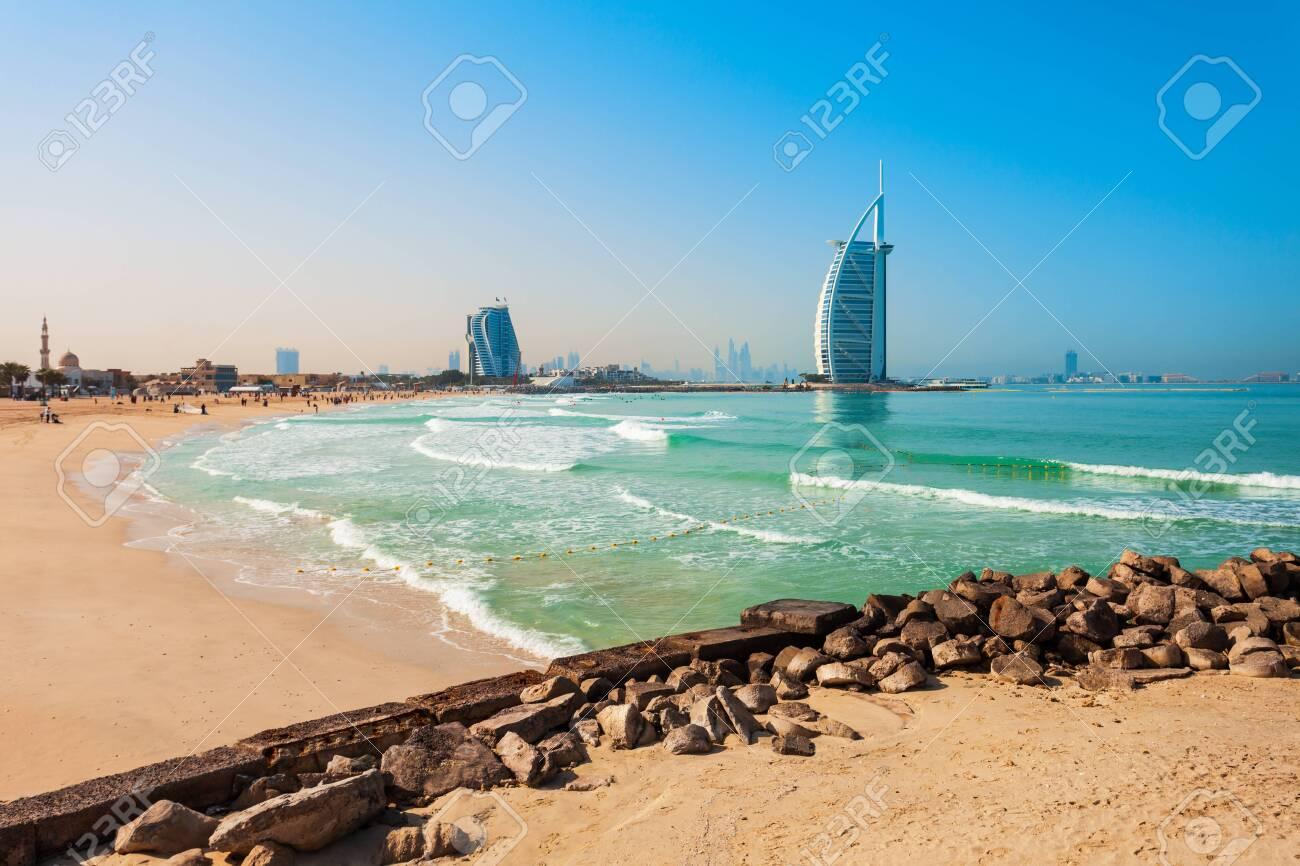 Burj Al Arab luxury hotel and Jumeirah public beach in Dubai city in UAE - 129568471