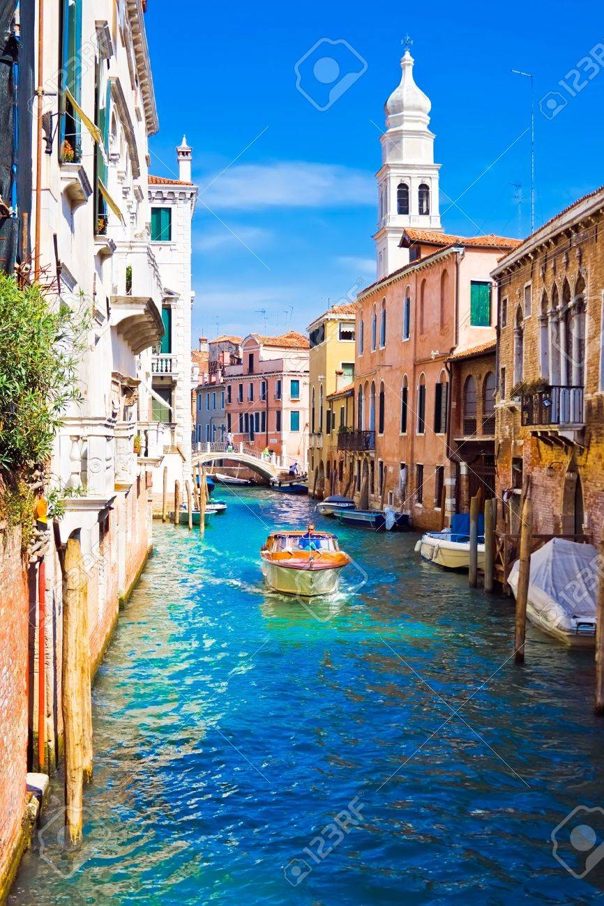 A boat in a canal in Venice, Italy Stock Photo - 4382186
