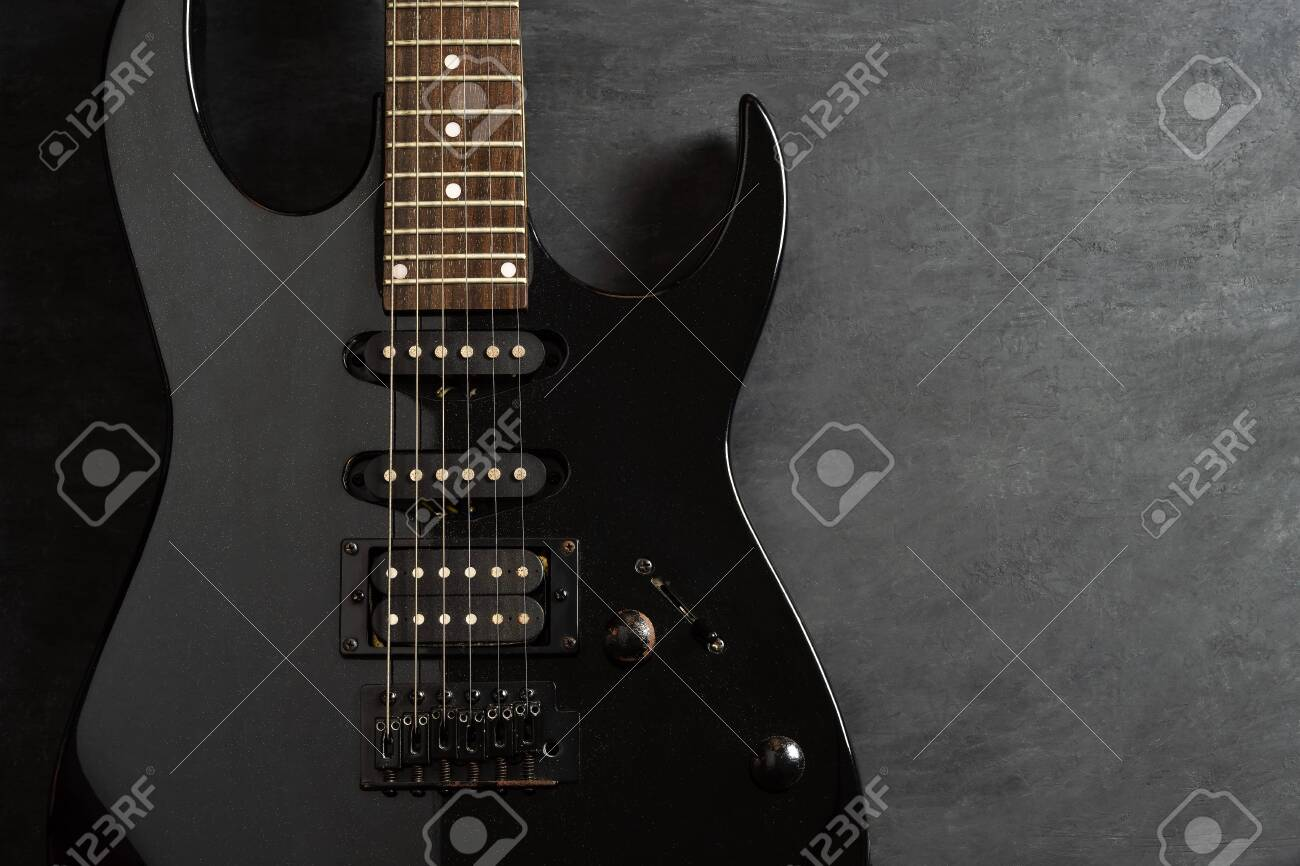 Closeup guitar on black cement floor. Top view and copy space for text. Concept of rock music. - 132667551