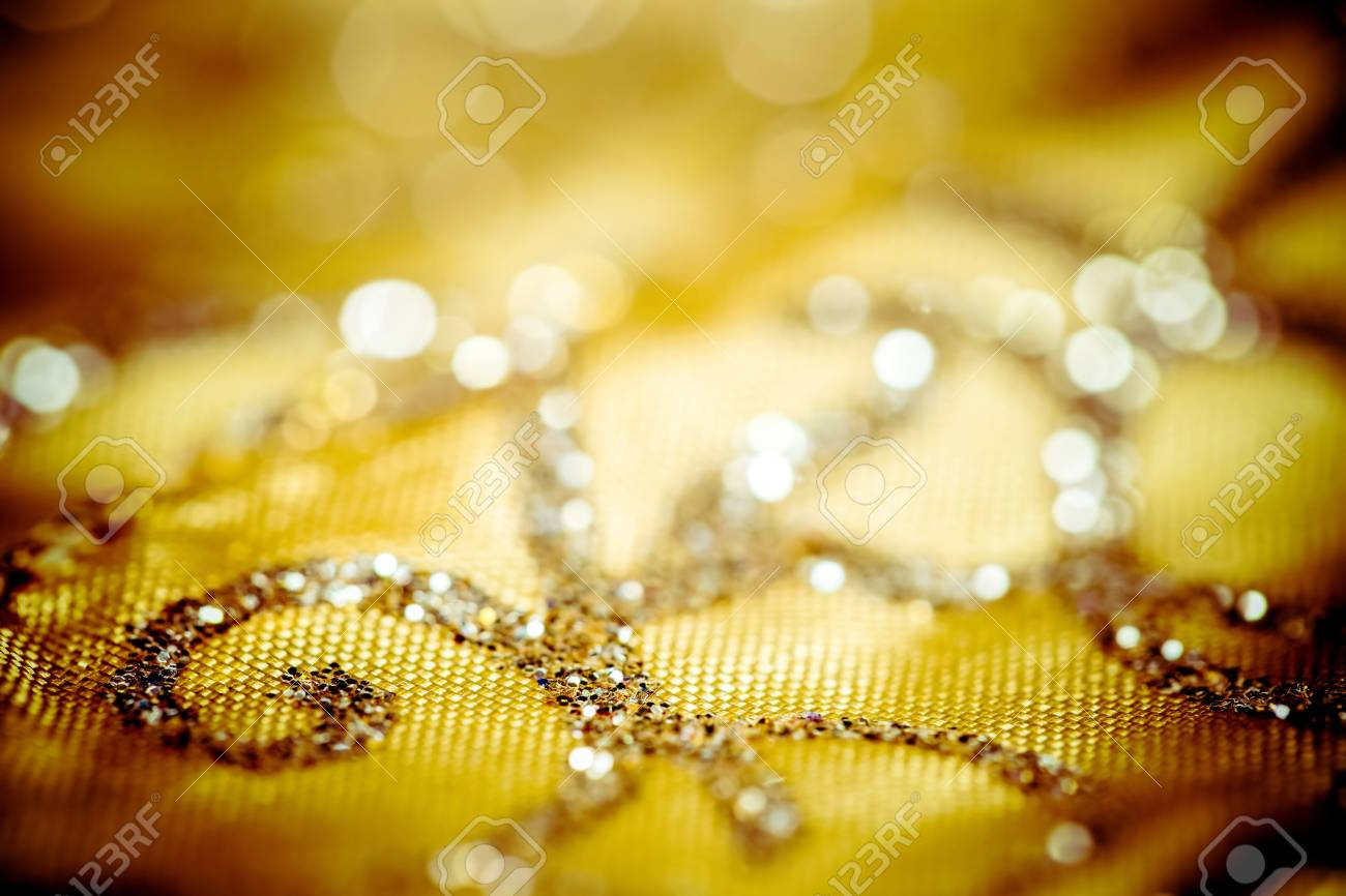 Golden Christmas tablecloth with decorative elements Stock Photo - 23665032