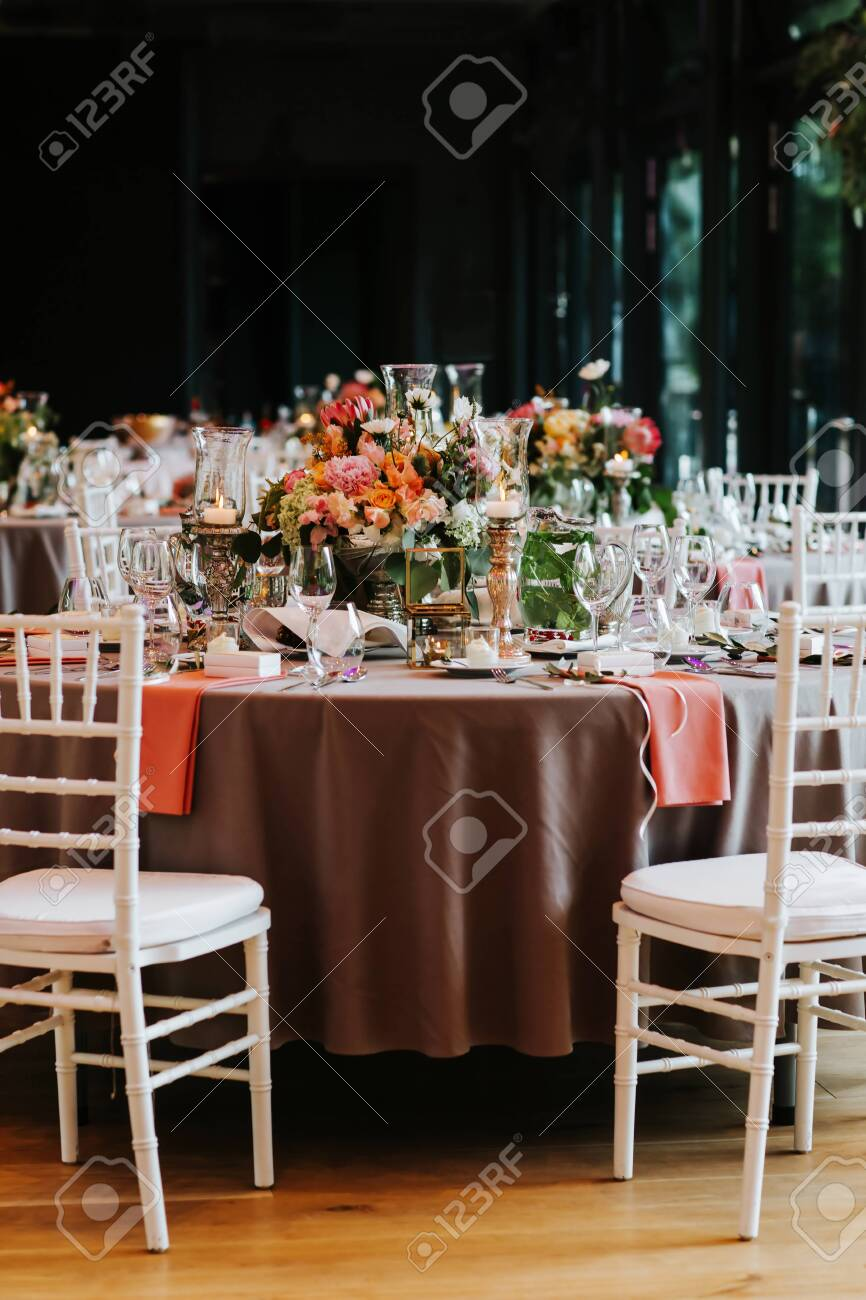 Beautiful, decorated table with flower decorations. Wedding or party decorations. - 148911592