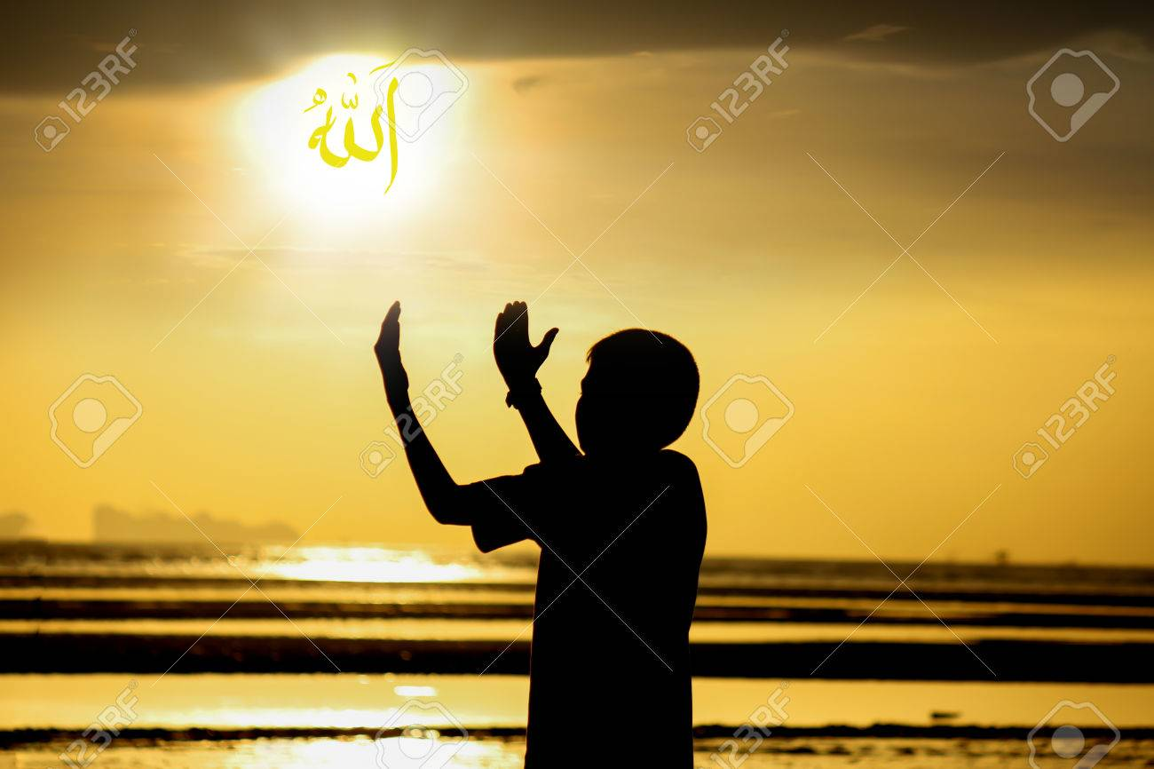 silhouette boy praying to allah on the beach at sunset arabic