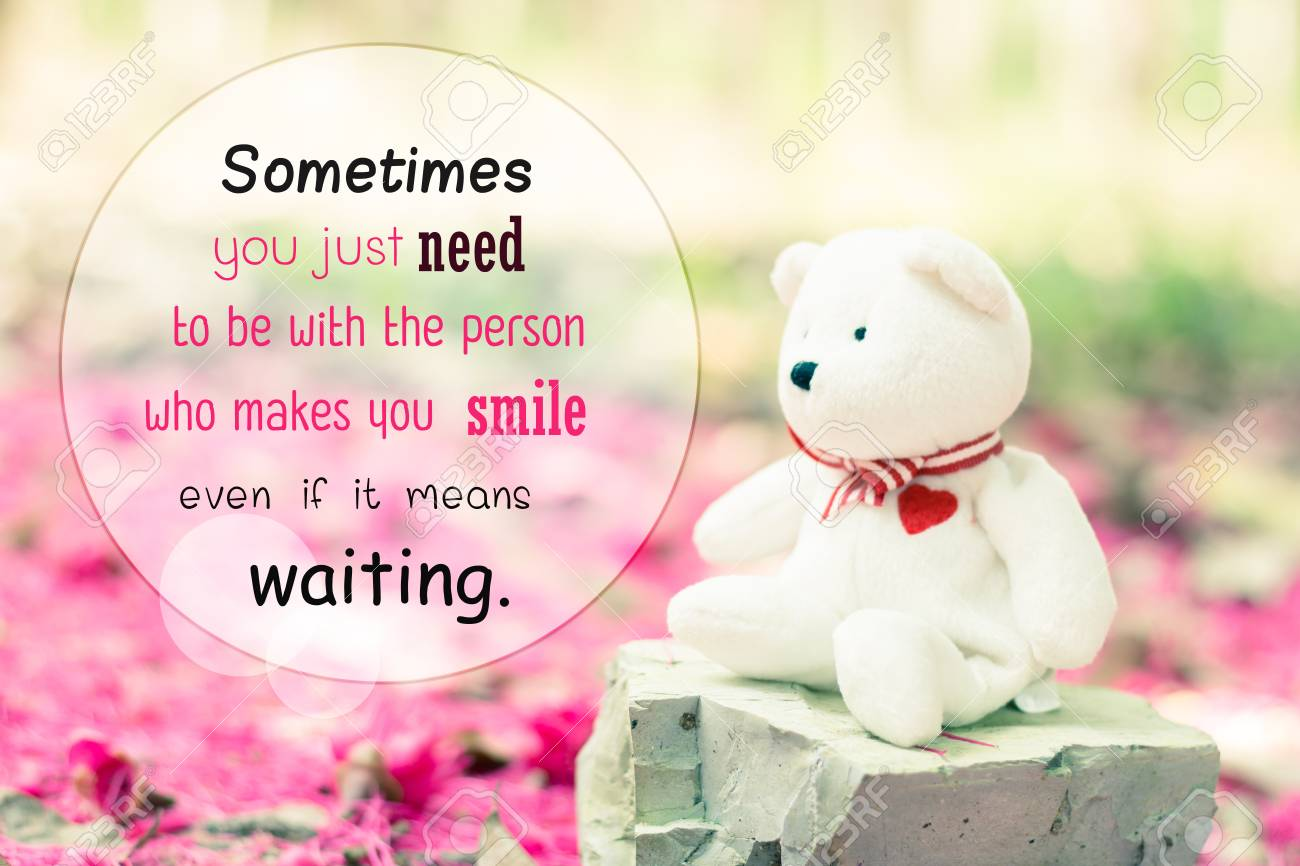 The teddy bear sitting at pink nature background , quotes on..