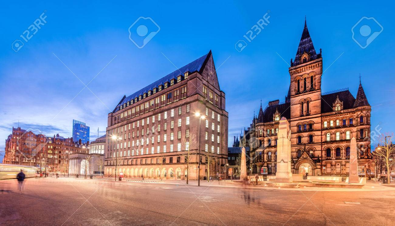 The old and new town hall buildings in the city centre of Manchester, England. - 49040069