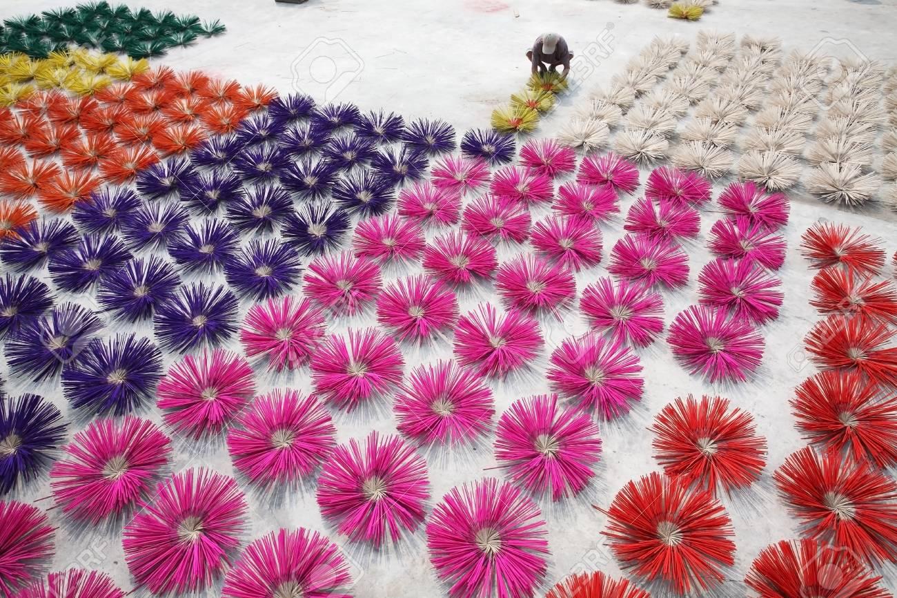man making colorful joss stick Stock Photo - 21473419