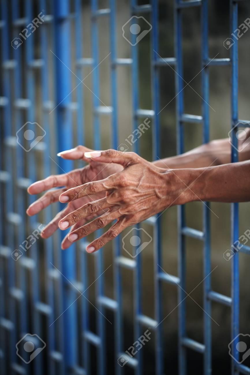hand in jail Stock Photo - 24131791