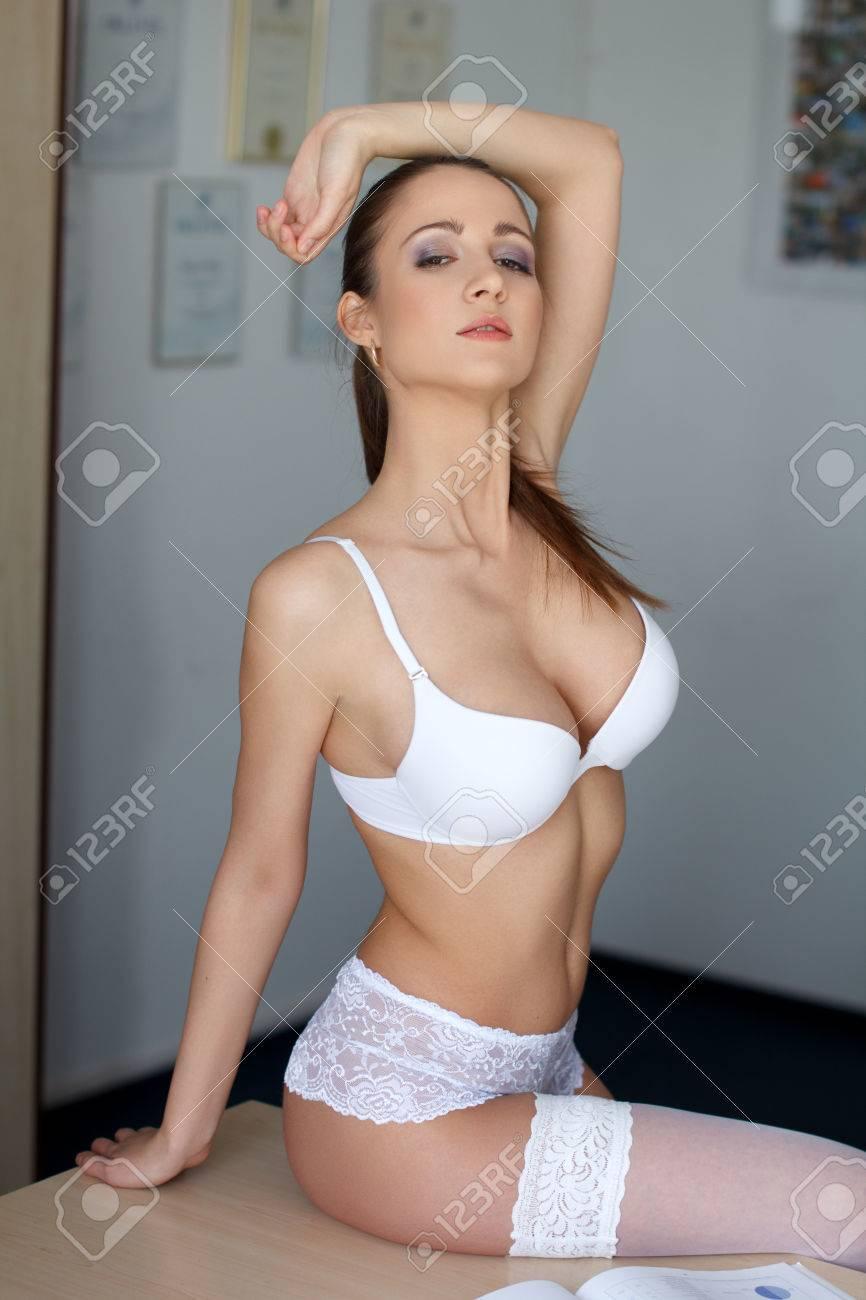Free Sexy Secretary Pics sexy secretary sitting on desk in office, desire