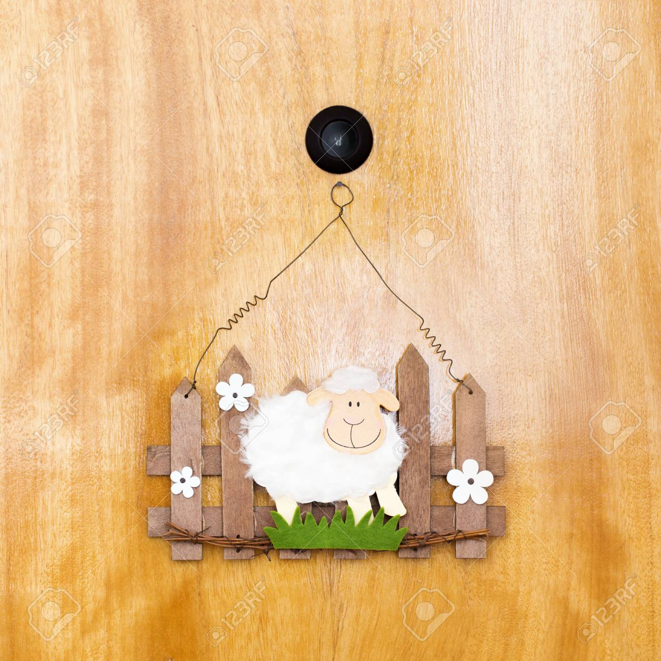 Easter welcome sheep with fence decoration on door
