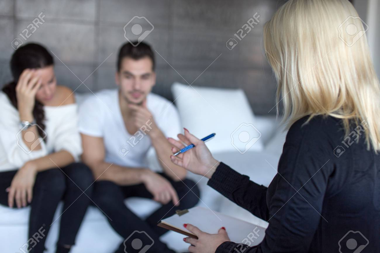 Blonde Therapist Discussing With Couple On Consulation Couple