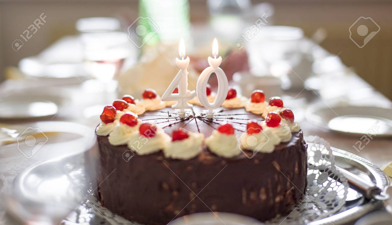Happy 40th Birthday Cake With Candles On Table Stock Photo
