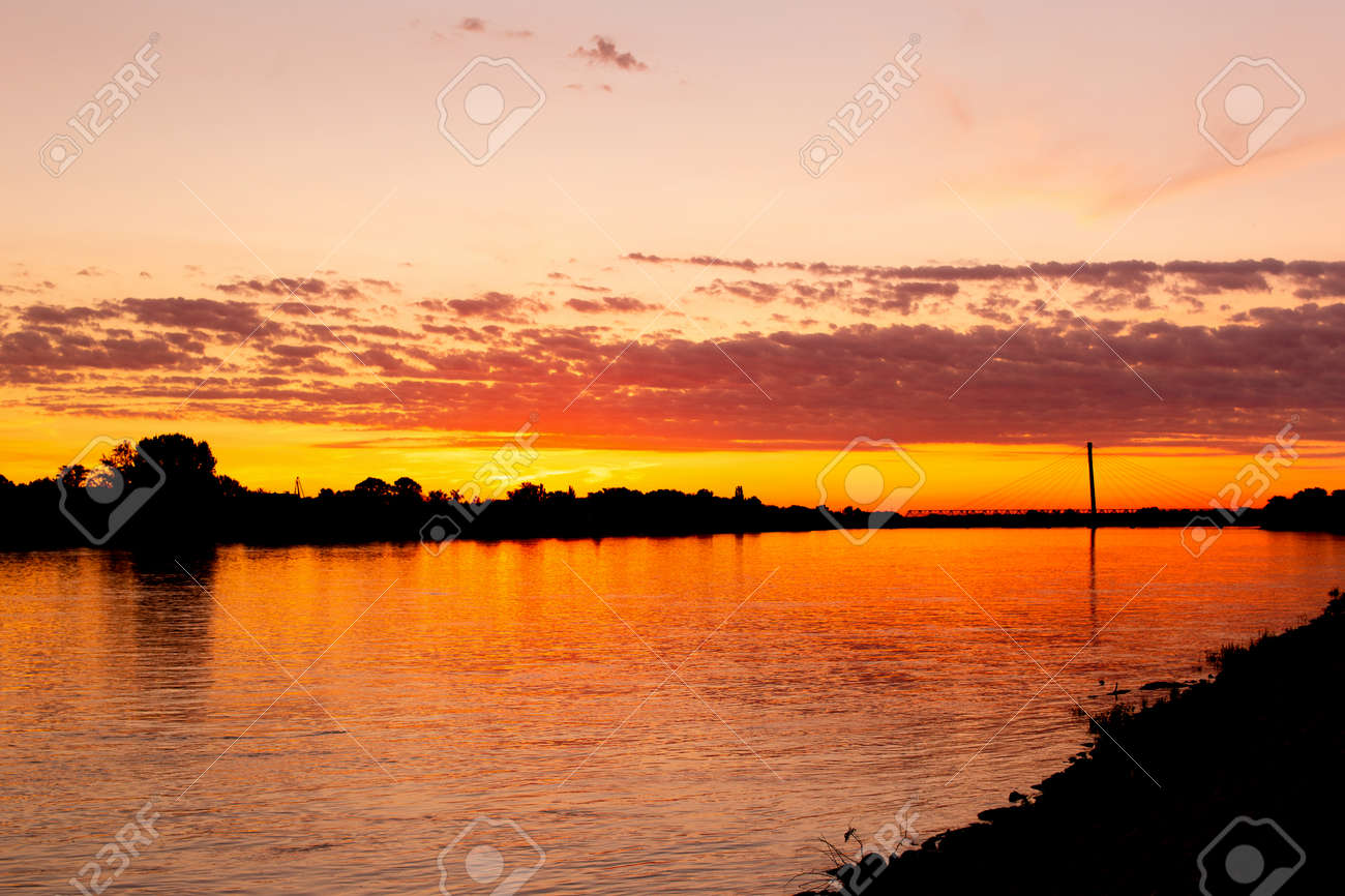 Colorful golden sunset at riverbank of Danube, Komarom, Hungary - 172747724