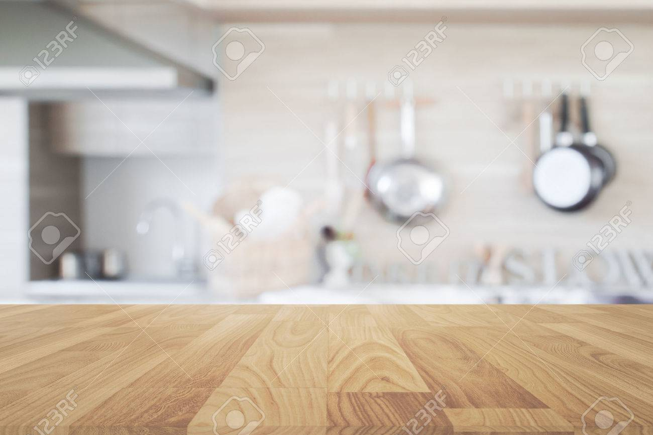 Wood table top with blur kitchen background , empty wooden table..