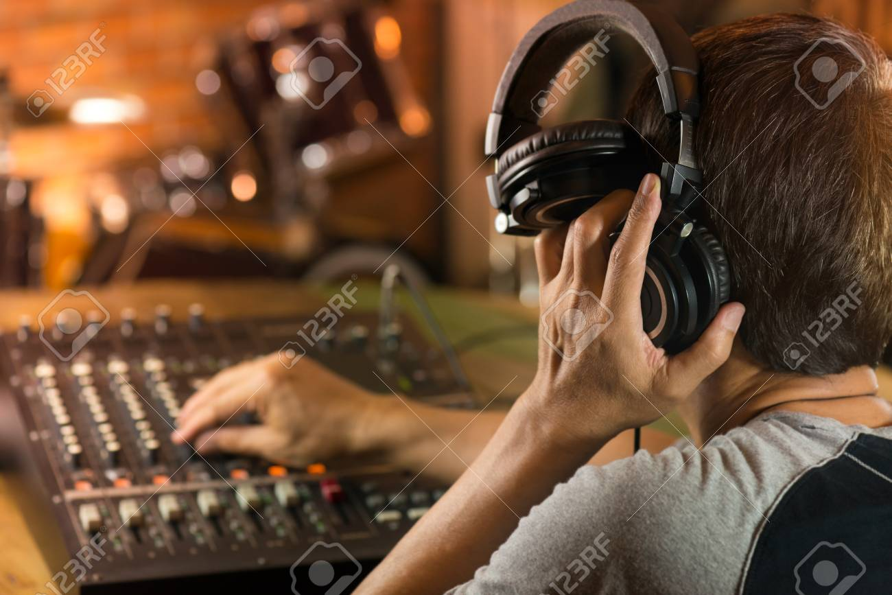 Man holding headphone and listening to live sound  Sound engineer