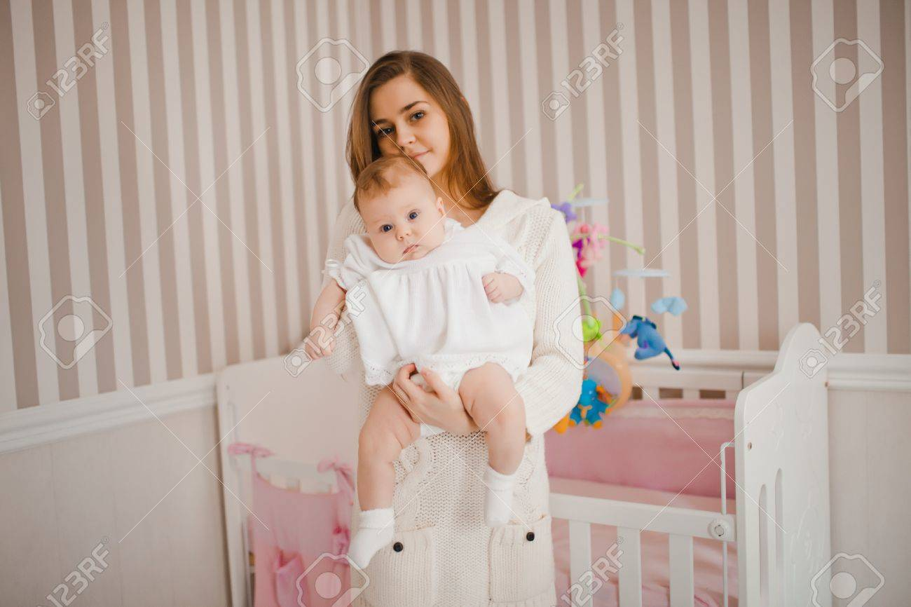 Young caucasian mother taking care of her baby Stock Photo - 17412740