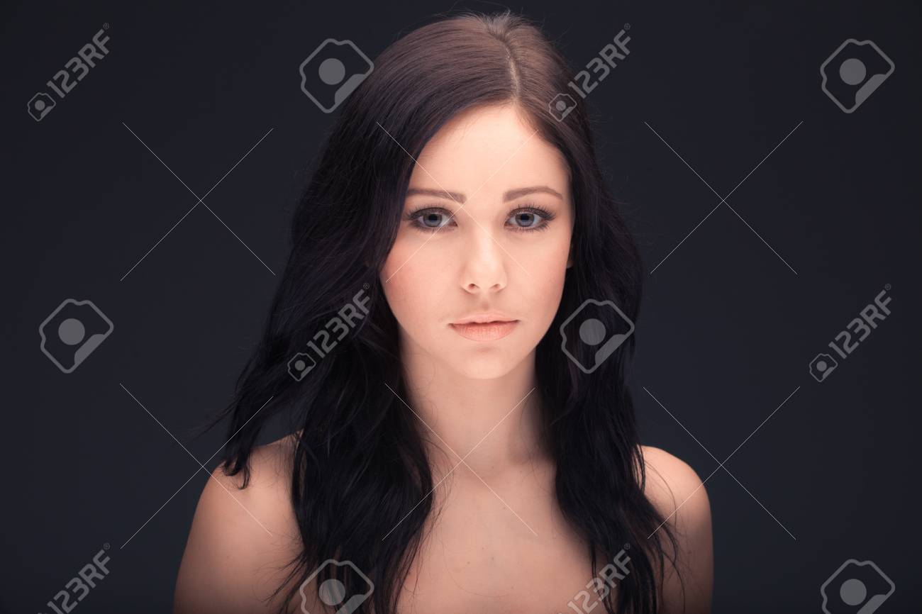 beautiful woman face and shoulders over dark background Stock Photo - 17803738