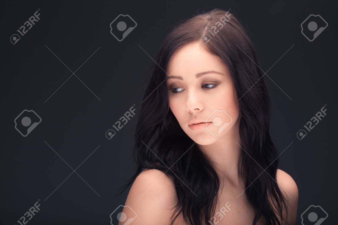 beautiful woman face and shoulders over dark background Stock Photo - 17803760