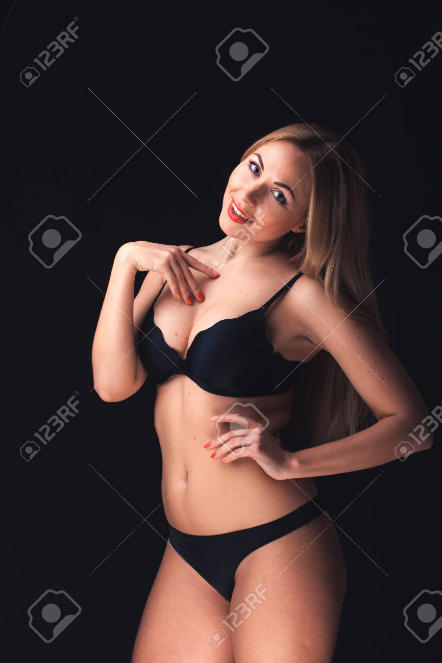 4d6d06a27 Beautiful and sexy woman wearing sensual lingerie on black background in  stuido Stock Photo - 18158529