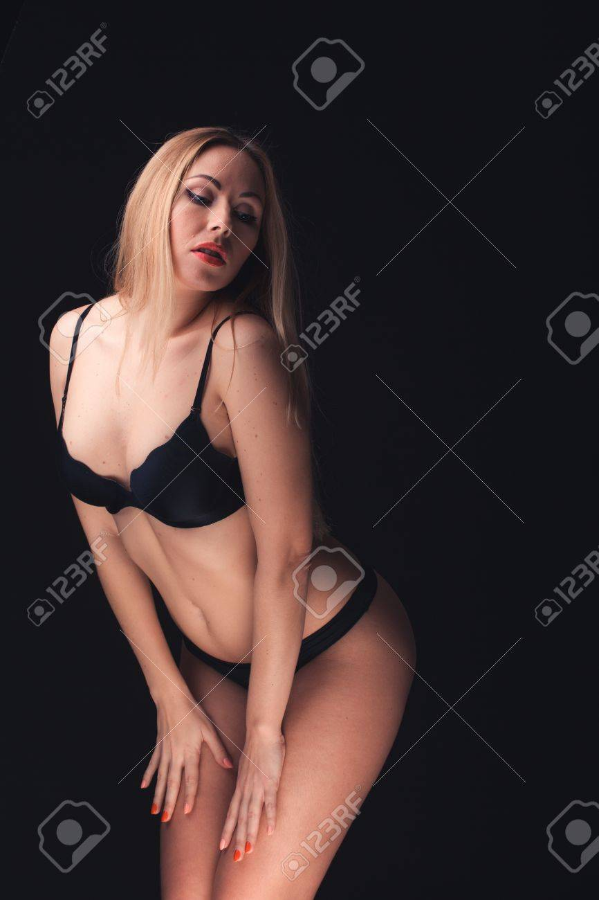 ba16cea25 Beautiful and sexy woman wearing sensual lingerie on black background in  stuido Stock Photo - 18158540