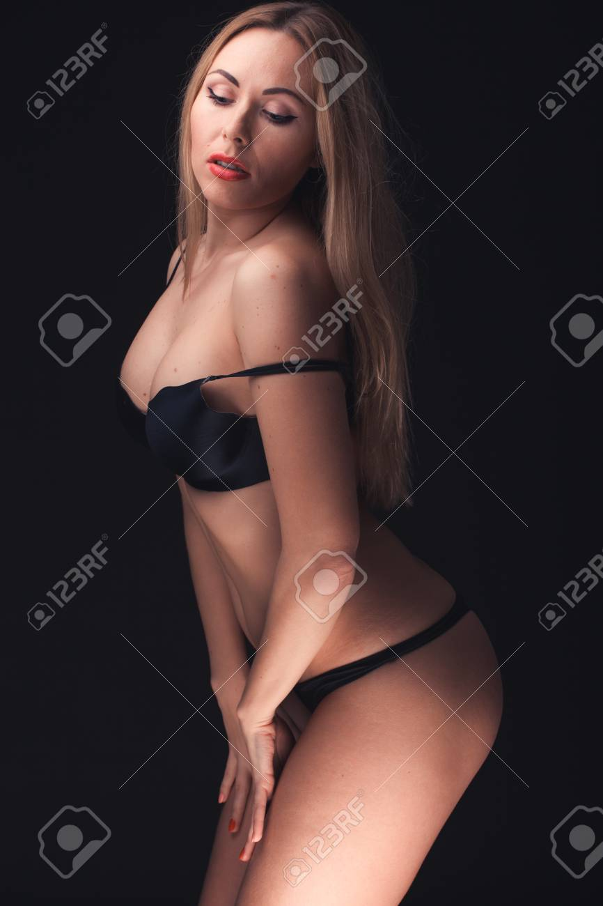 Beautiful and sexy woman wearing sensual lingerie on black background in  stuido Stock Photo - 18158497 b098acd36fd