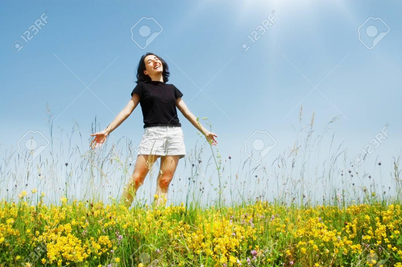 Beautiful young girl enjoying sunshine Stock Photo - 11957777