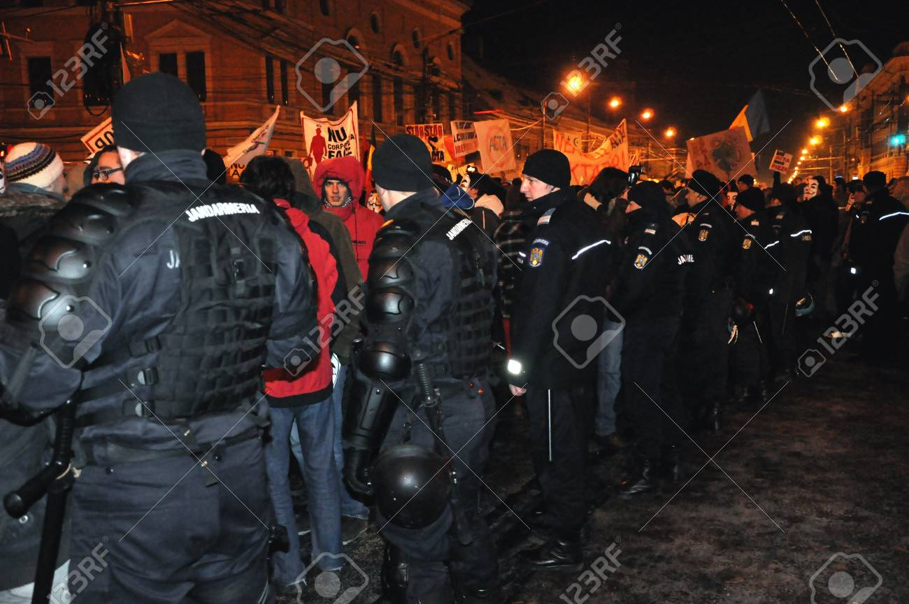 CLUJ NAPOCA - FEBRUARY 11: Special unit policemans controlling the street during a protest against ACTA, the web piracy treaty, and the government on February 11, 2012 in Cluj Napoca, Romania Stock Photo - 12257755