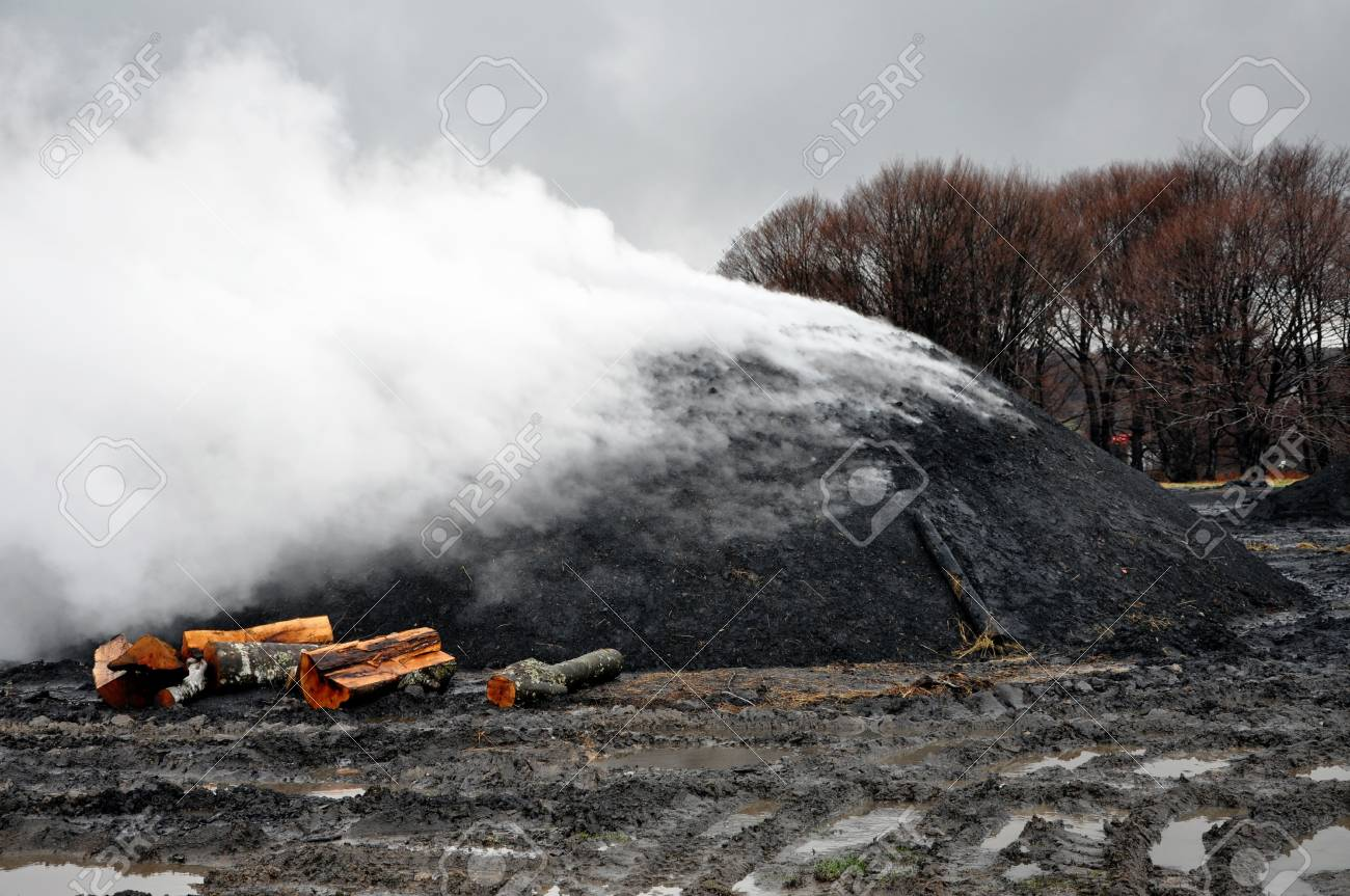 Charcoal pile burning in the outdoors, Romania Stock Photo - 13345822