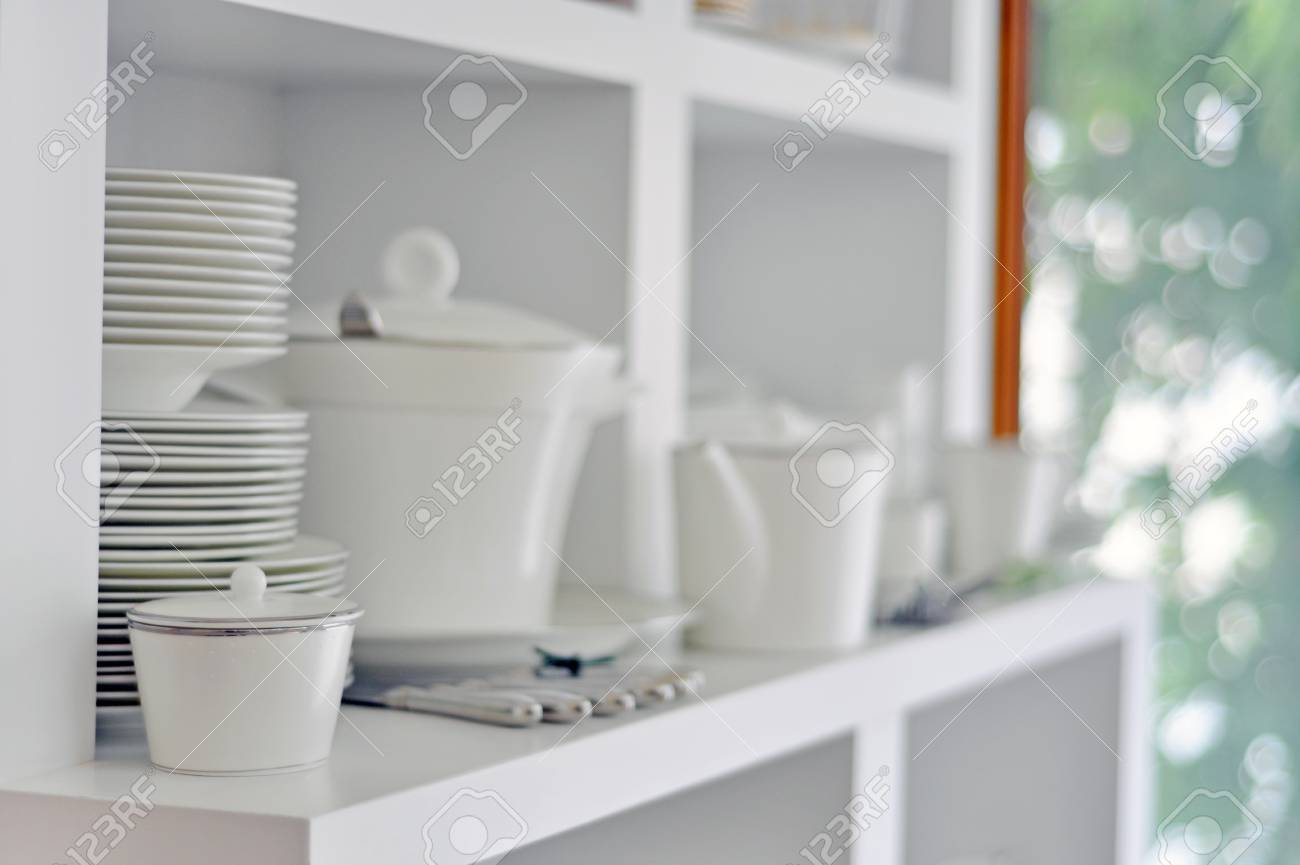 China dish, tableware and cutlery in a bright kitchen Stock Photo - 14364799