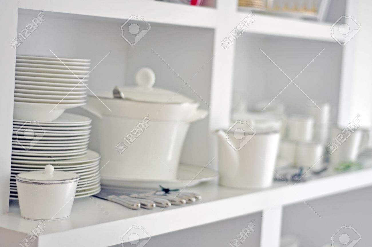 Bright Kitchen China Dish Tableware And Cutlery In A Bright Kitchen Stock Photo