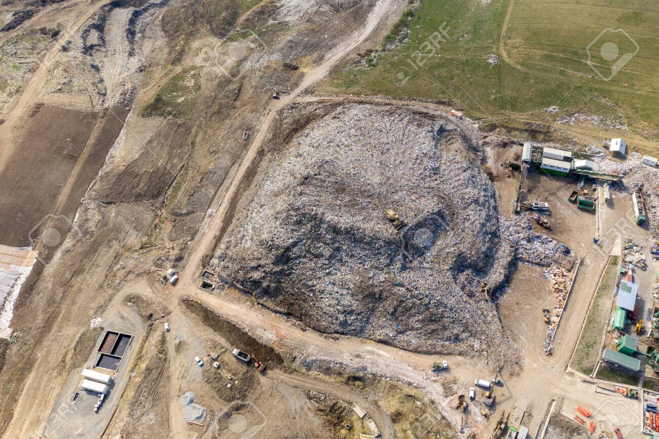 Aerial top drone view of large garbage pile, trash dump, landfill,