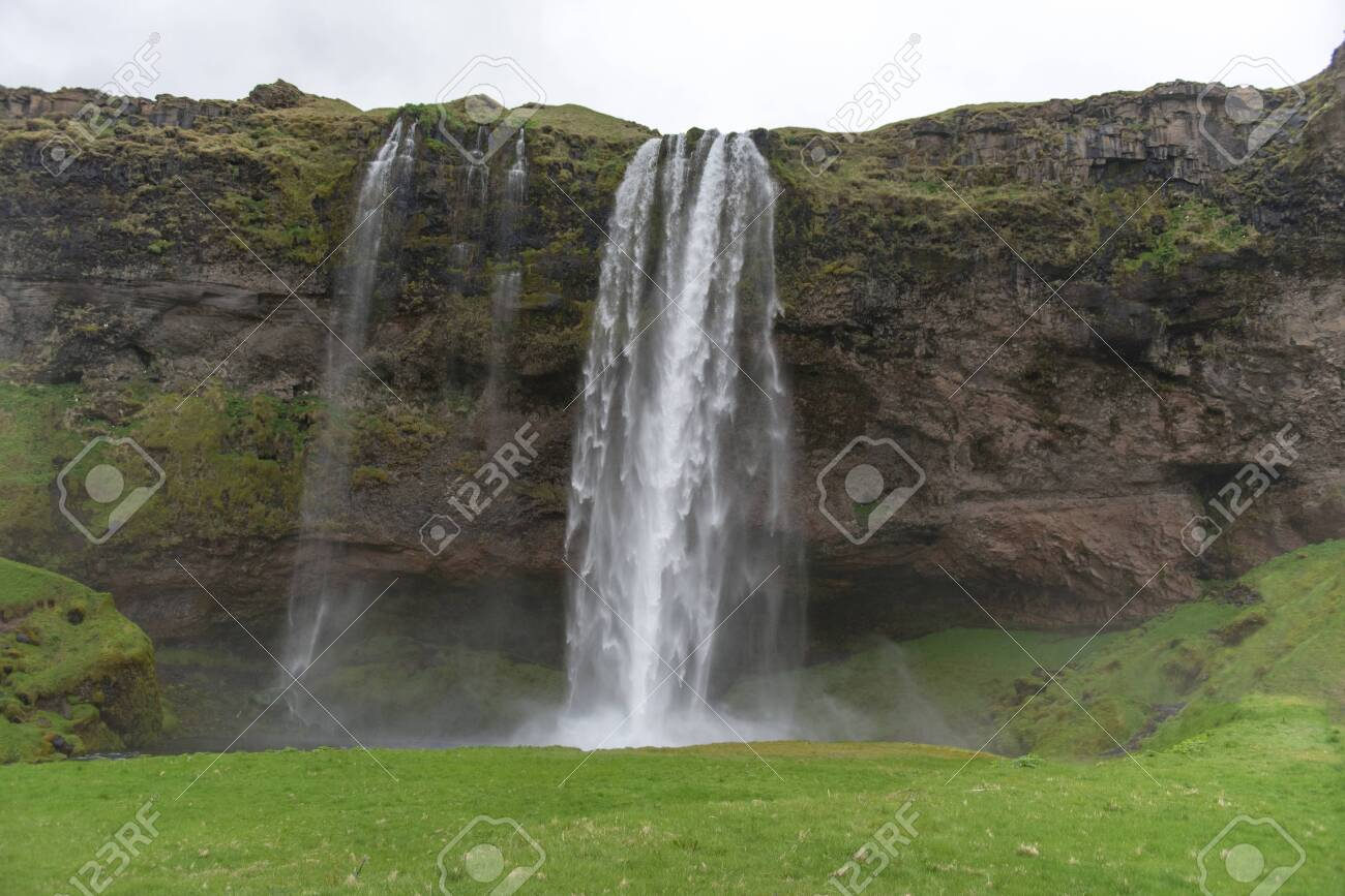 Seljalandsfoss waterfall, on the Ring Road in Southern Iceland - 124364877