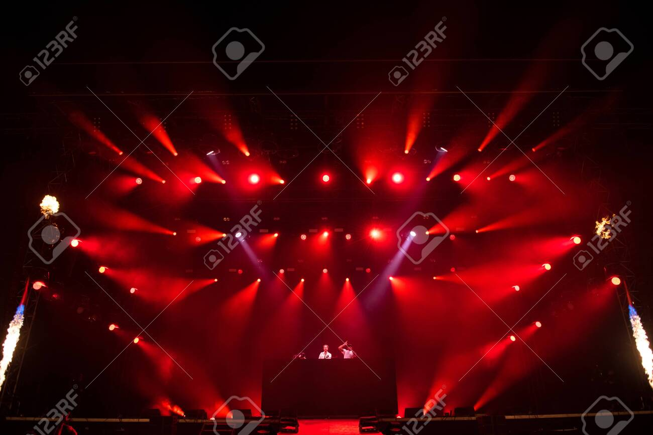 BONTIDA, ROMANIA - JULY 19, 2019: British drum and bass DJ band Sigma mixing live on the stage during a concert at Electric Castle festival - 137976954