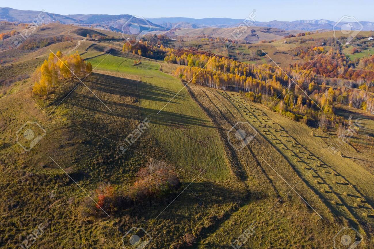 Aerial drone shot over autumn scenery in Transylvania, Romania - 128652320