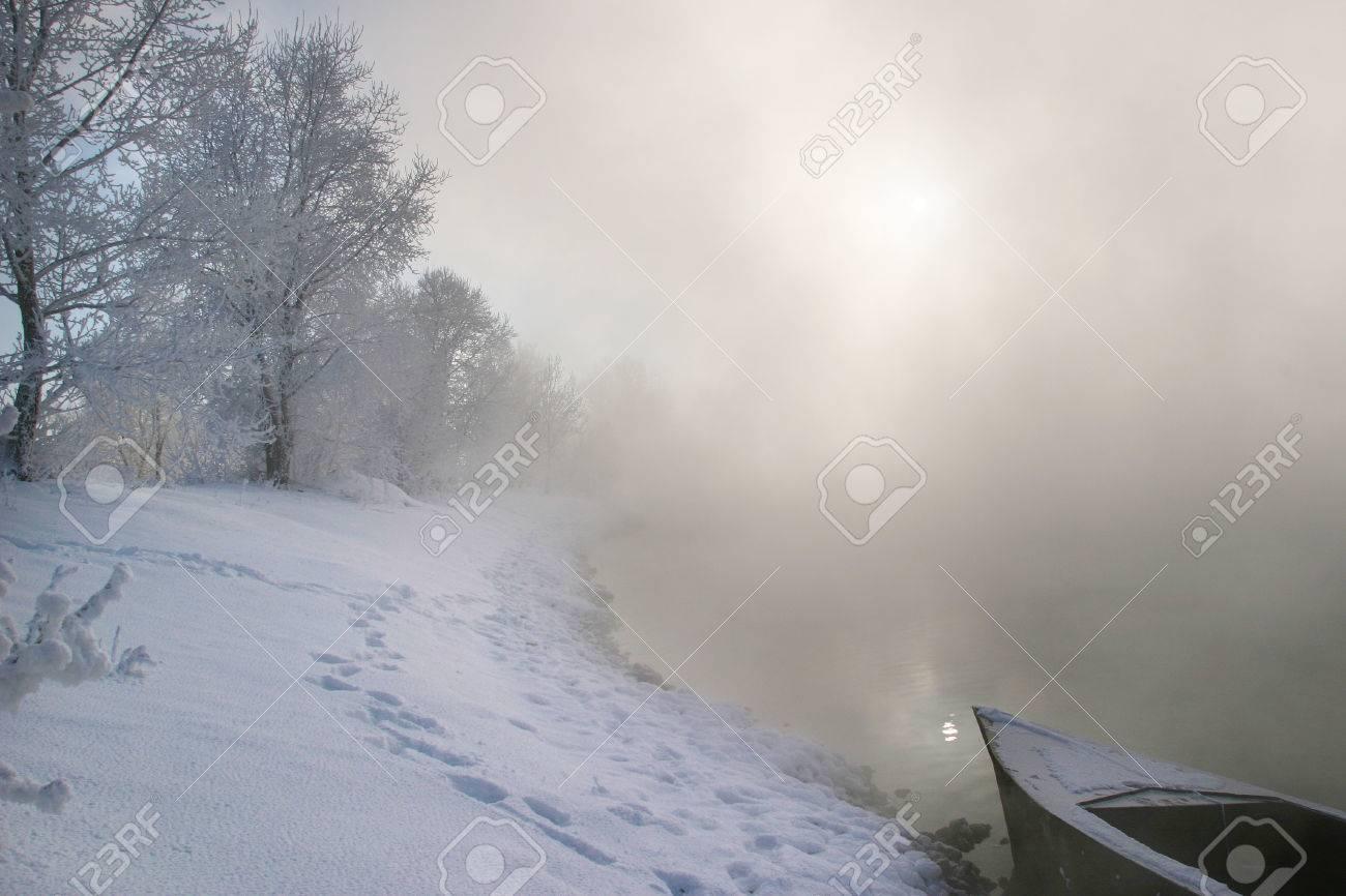winter landscape misty morning on the river at sunrise - 23216258