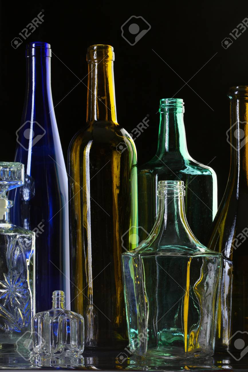 close up collection of beautiful colored glass bottles on black studio stock photo 26308806 - Colored Glass Bottles