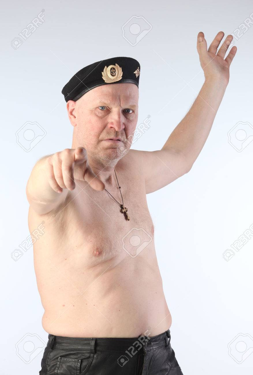 6e00147324040 close-up portrait of the adult white male with naked torso and a black beret