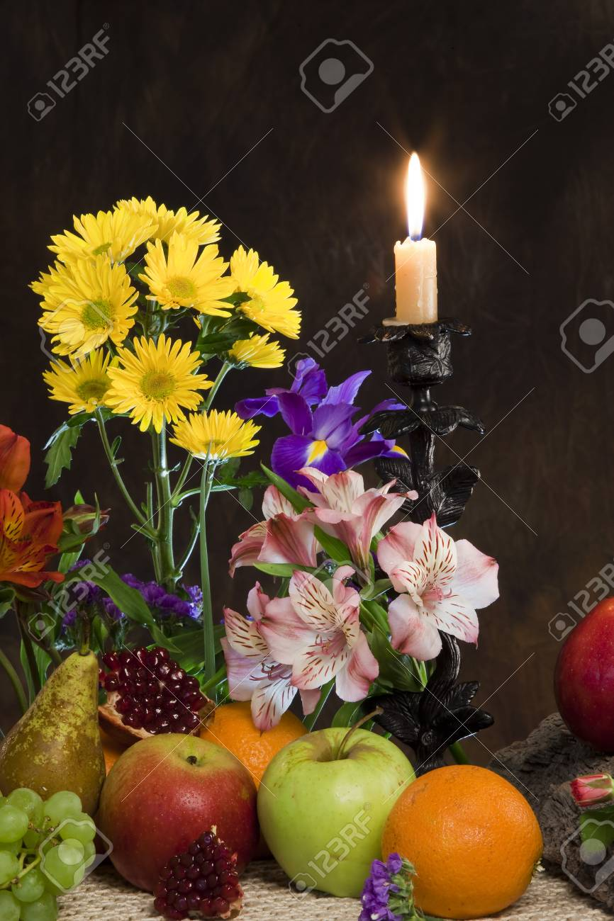 Close Up Elegant Still Life Of Various Ripe Fruits And Delicate Flowers On A Dark
