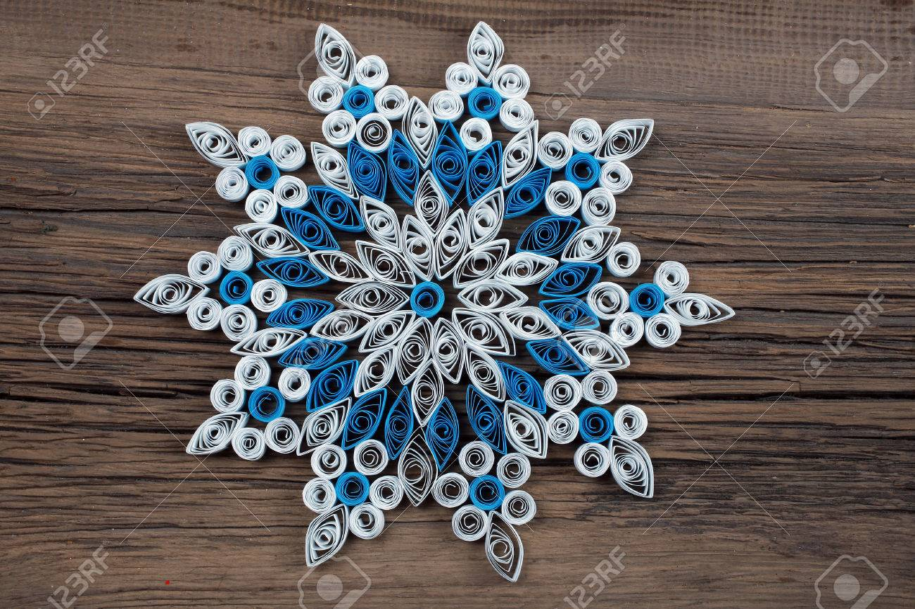 close up of a snowflake out of paper quilling technique against