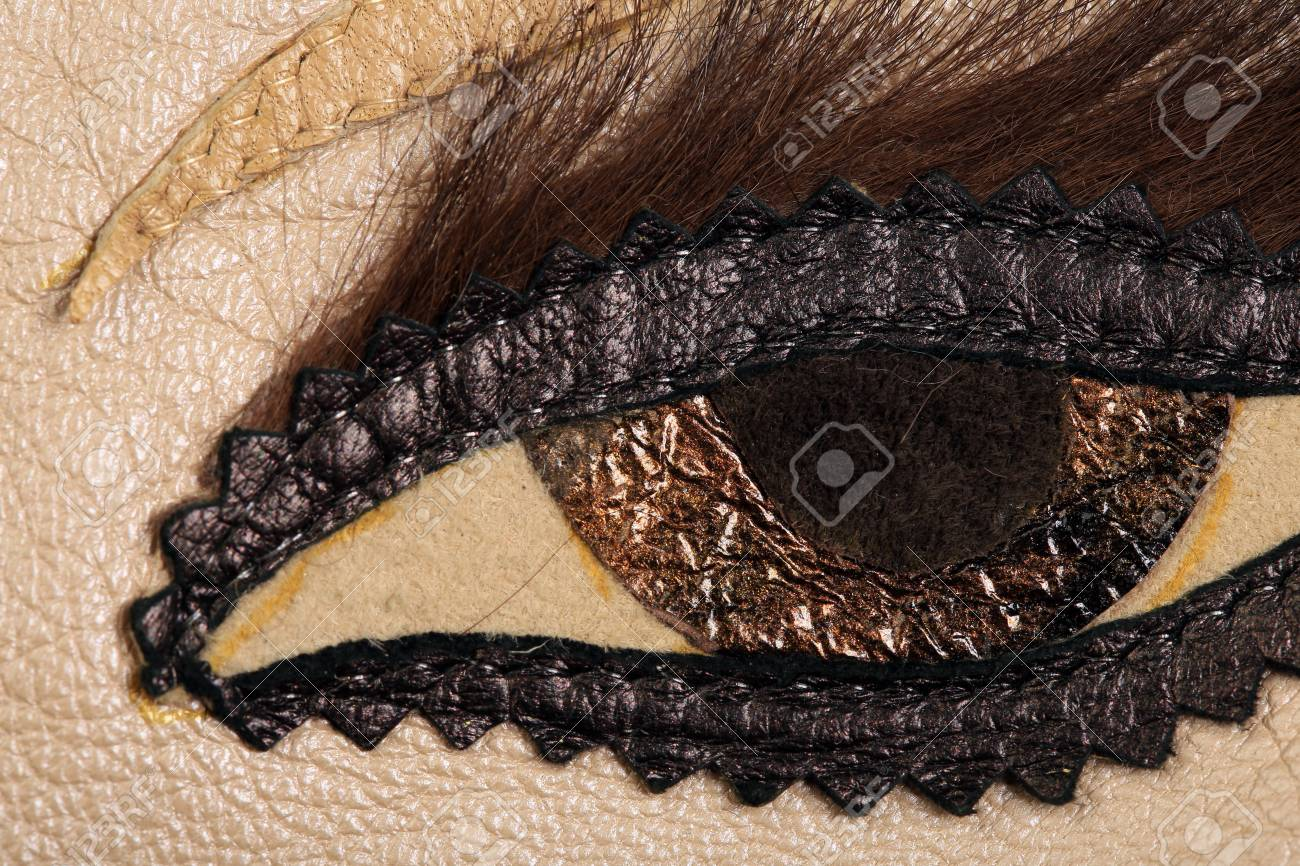 Macro texture brown leather applique in the form of eyes studio