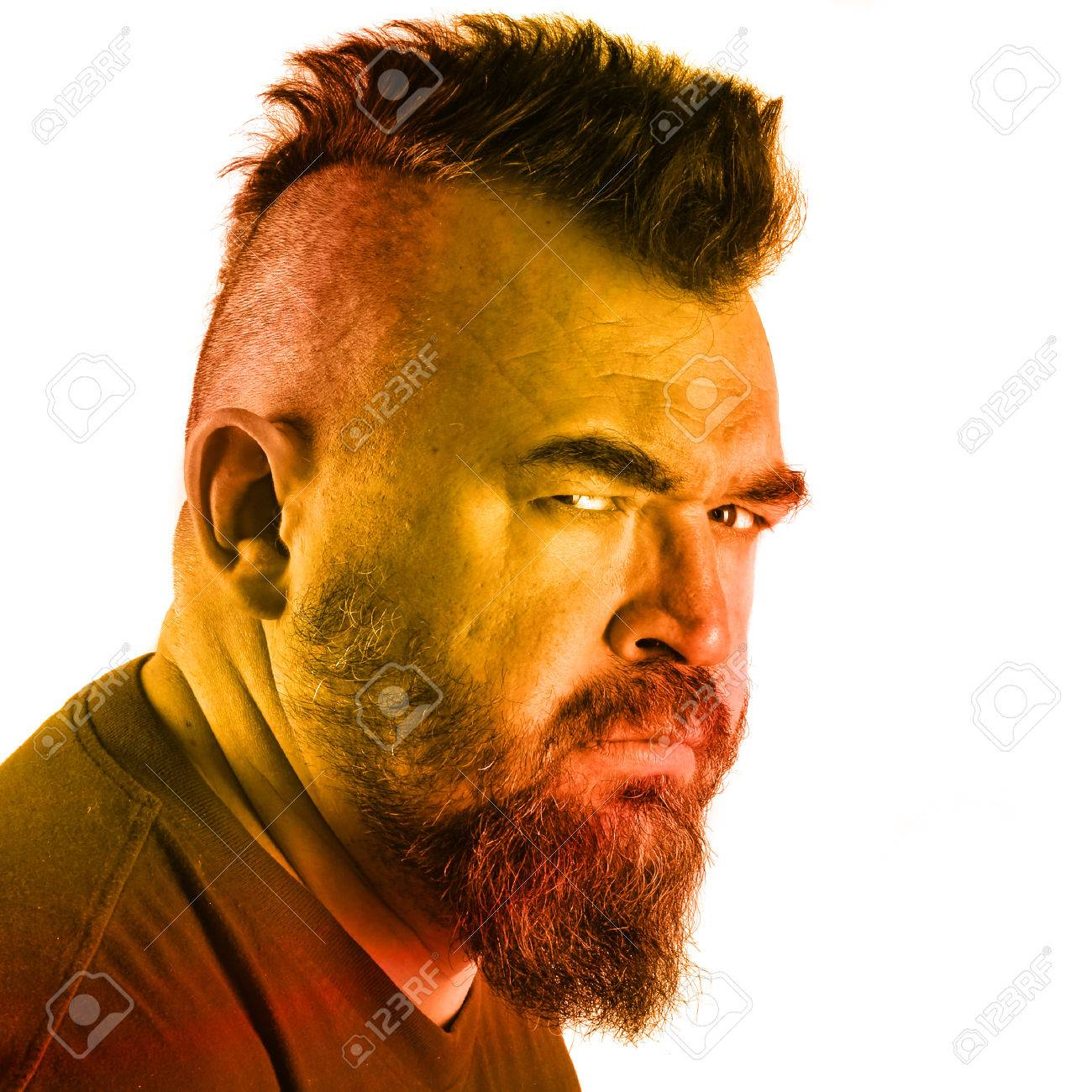 close up portrait profile of a angry white man with mohawk and