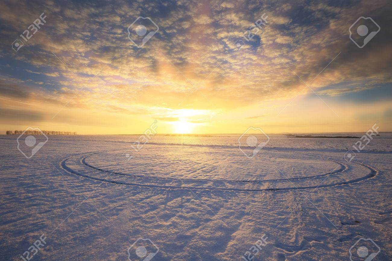 winter landscape colorful sunrise over the snow-covered field - 71390514