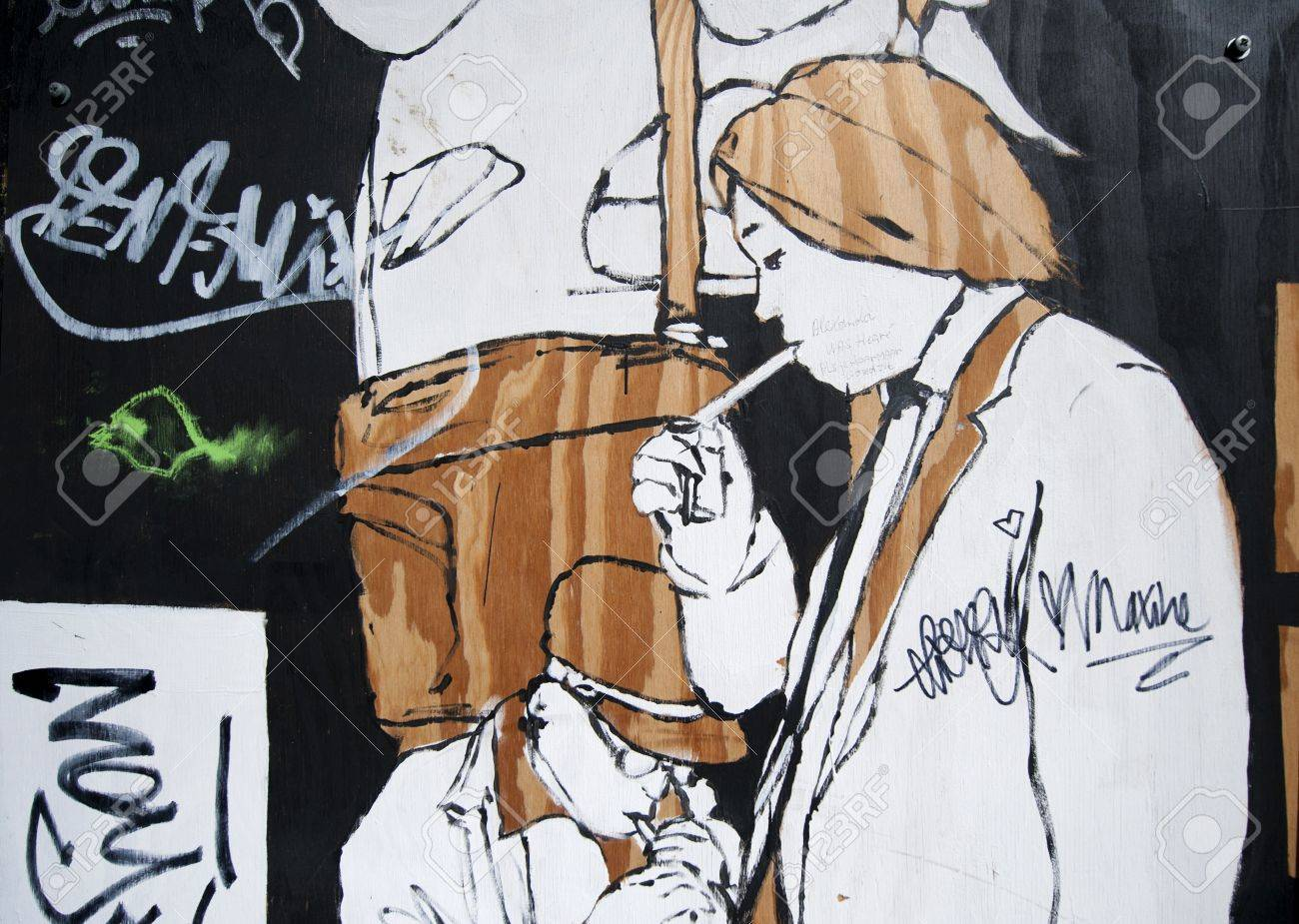 Graffiti art on wood - Detail Of Graffiti Street Art On Wood Boards In Public Domain Of Stylised Men Lighting Cigarettes