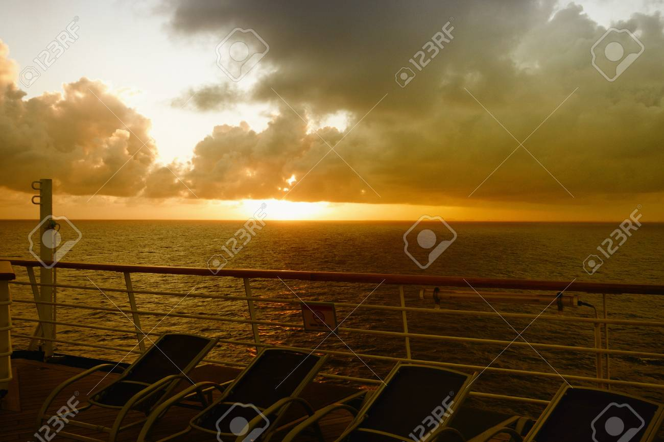 Sunset over the sea with sunloungers on the deck of a ship Stock Photo - 13322694