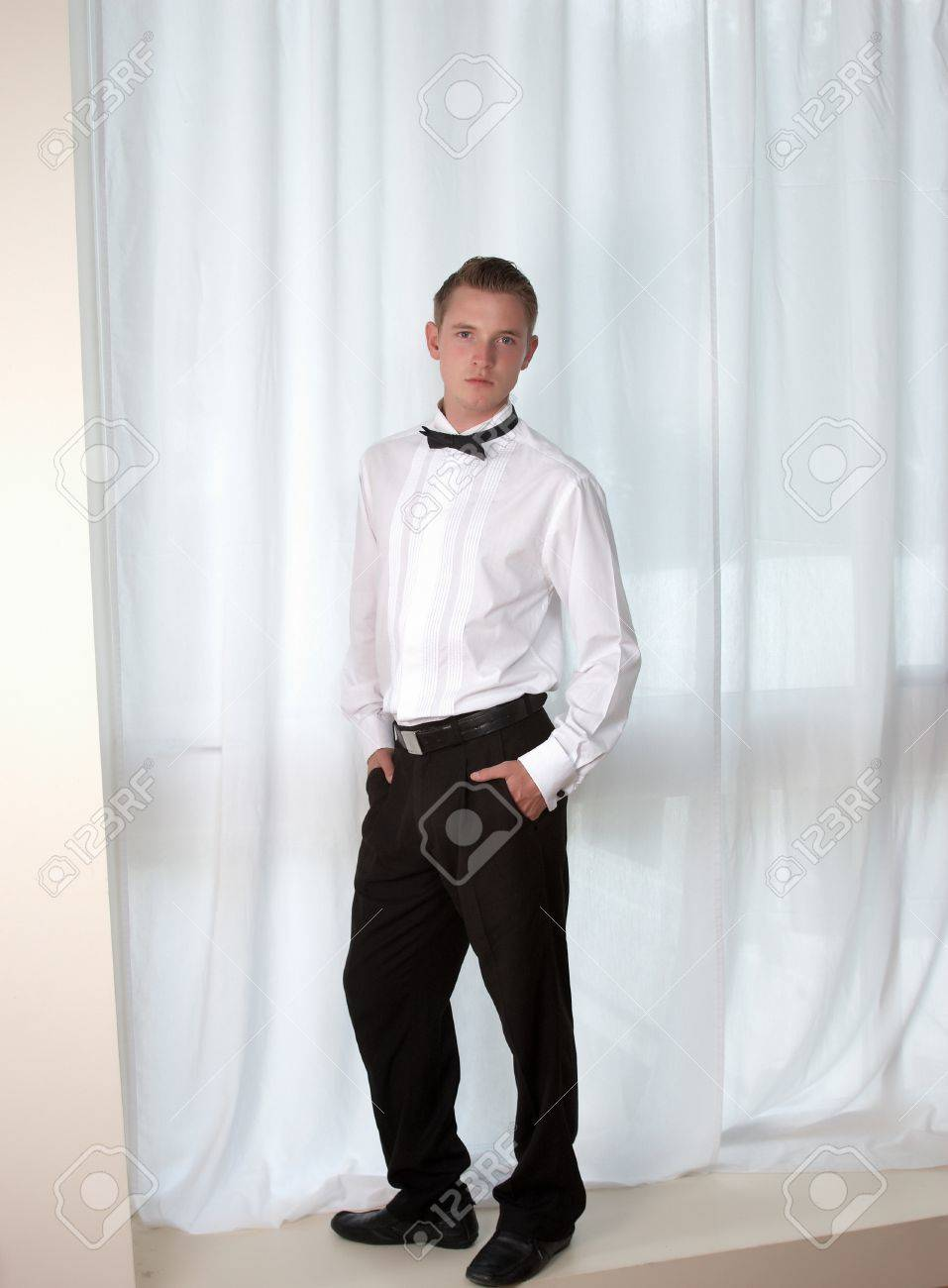 A Young Man In Smart Dress White Shirt And Bow Tie Stock Photo