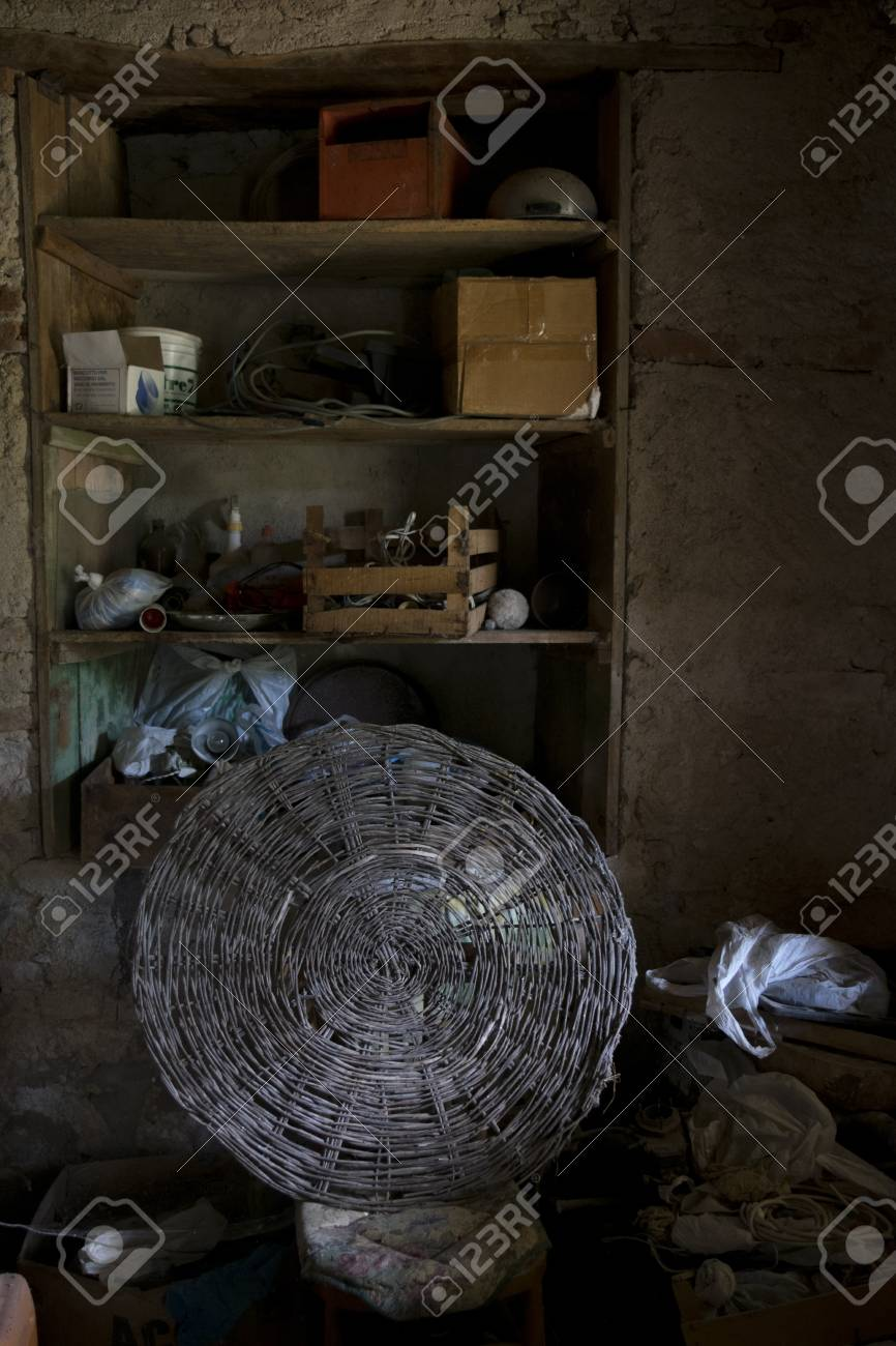 Old Attic With Wooden Ceiling And Scattered Knick Knack