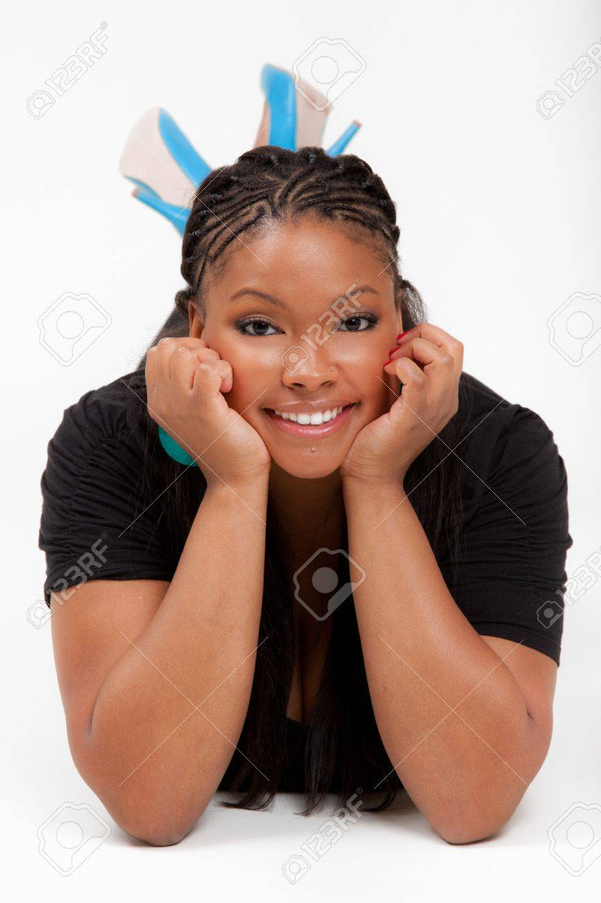 Portrait of a young beautiful black woman lied on the floor and smiling Stock Photo - 9389533