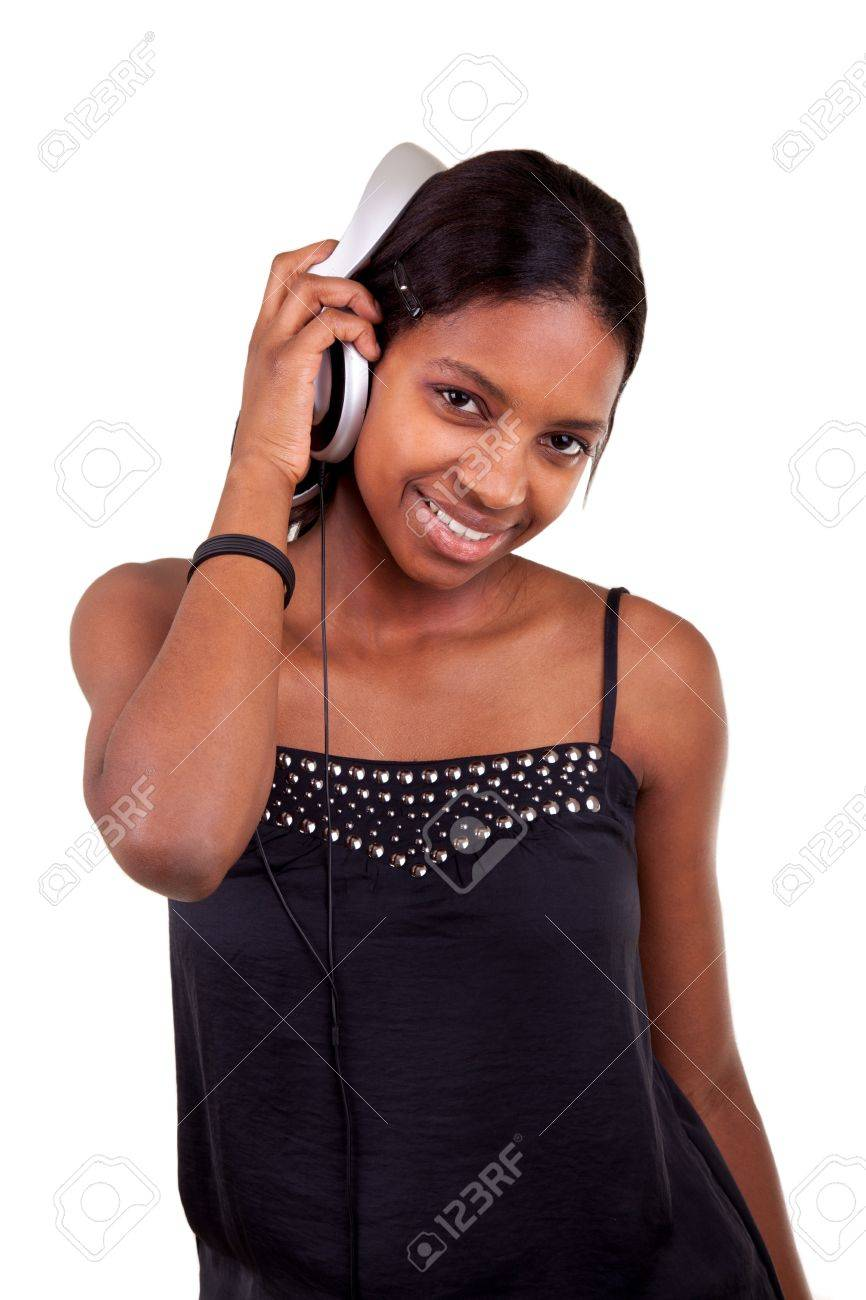 Young beautiful african american woman listening to music Stock Photo - 9436946