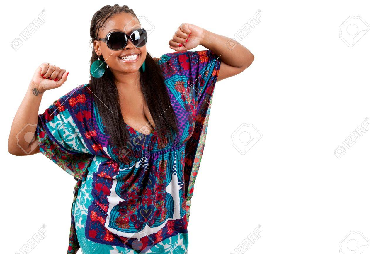 Portrait of beautiful young african american woman dancing against white background Stock Photo - 9536844