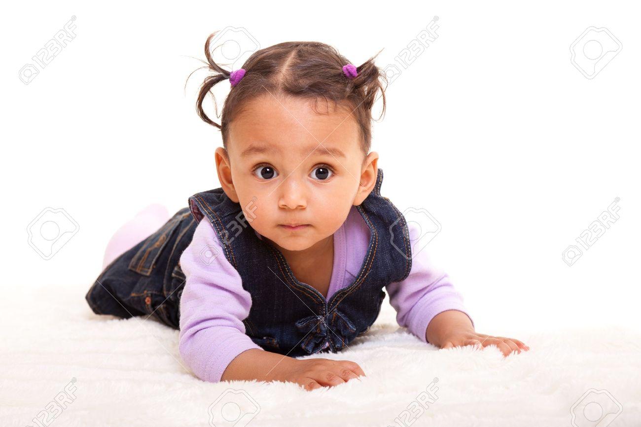 Beautiful mixed race baby lying on the floor Stock Photo - 10223655