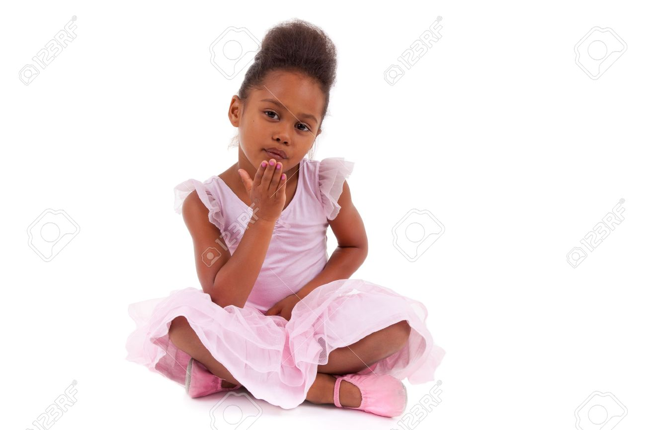 Cute little African Asian girl sitting on the floor,  isolated on white background Stock Photo - 10842539