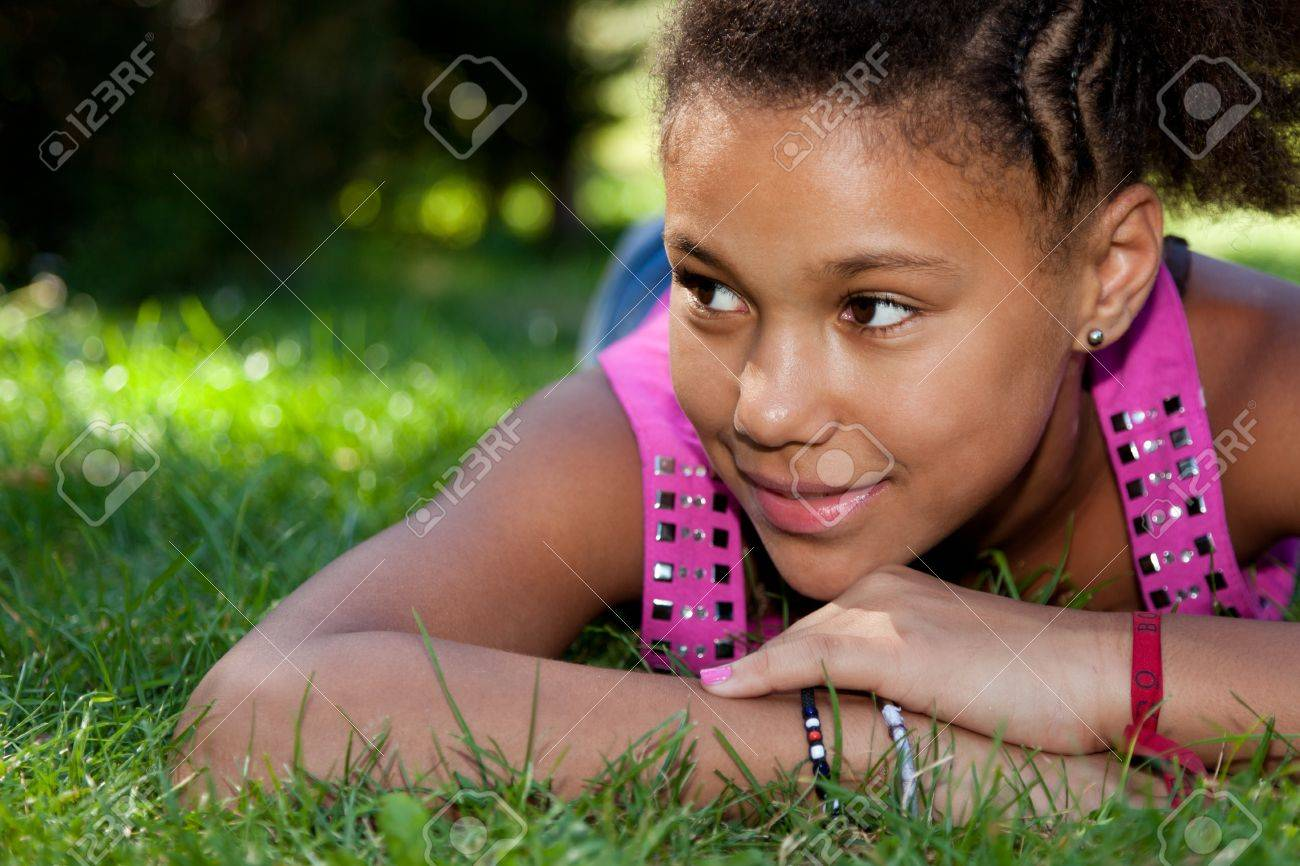 Young african american teenage girl  lying on the grass Stock Photo - 10842542